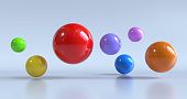 colorful glossy spheres flying isolated on white background