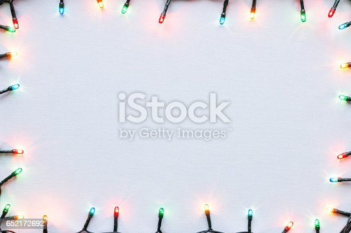 istock colorful glowing garland on white background Christmas frame mockup 652172692