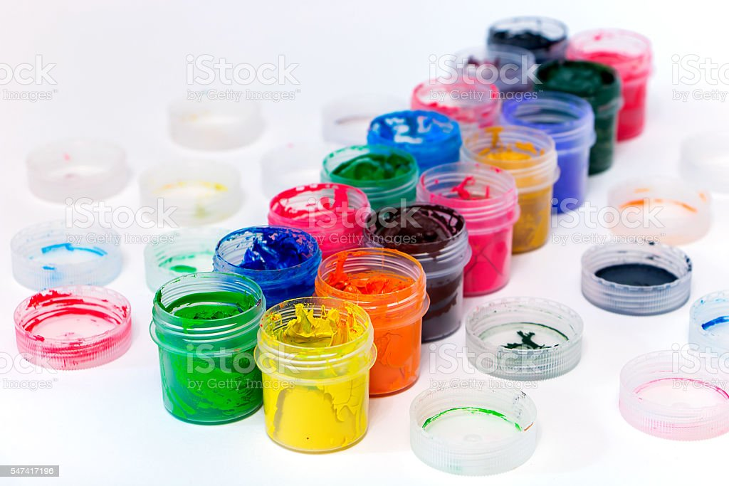 colorful gouache in jars stock photo