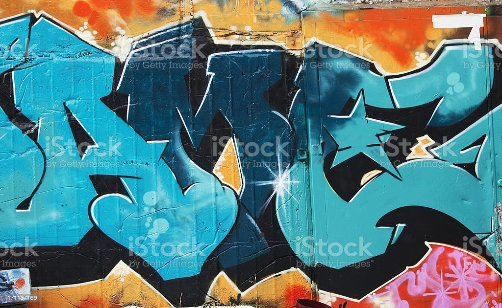 Colorful graffiti on a concrete wall. stock photo
