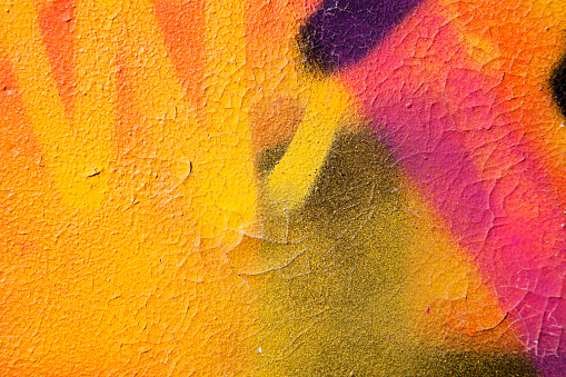 istock Colorful graffiti over a cracked surface 182213322