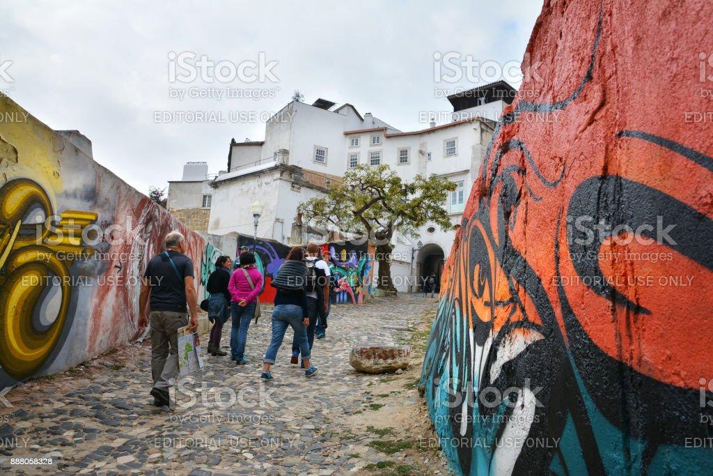 Colorful graffiti street in Alfama quarter, Lisbon