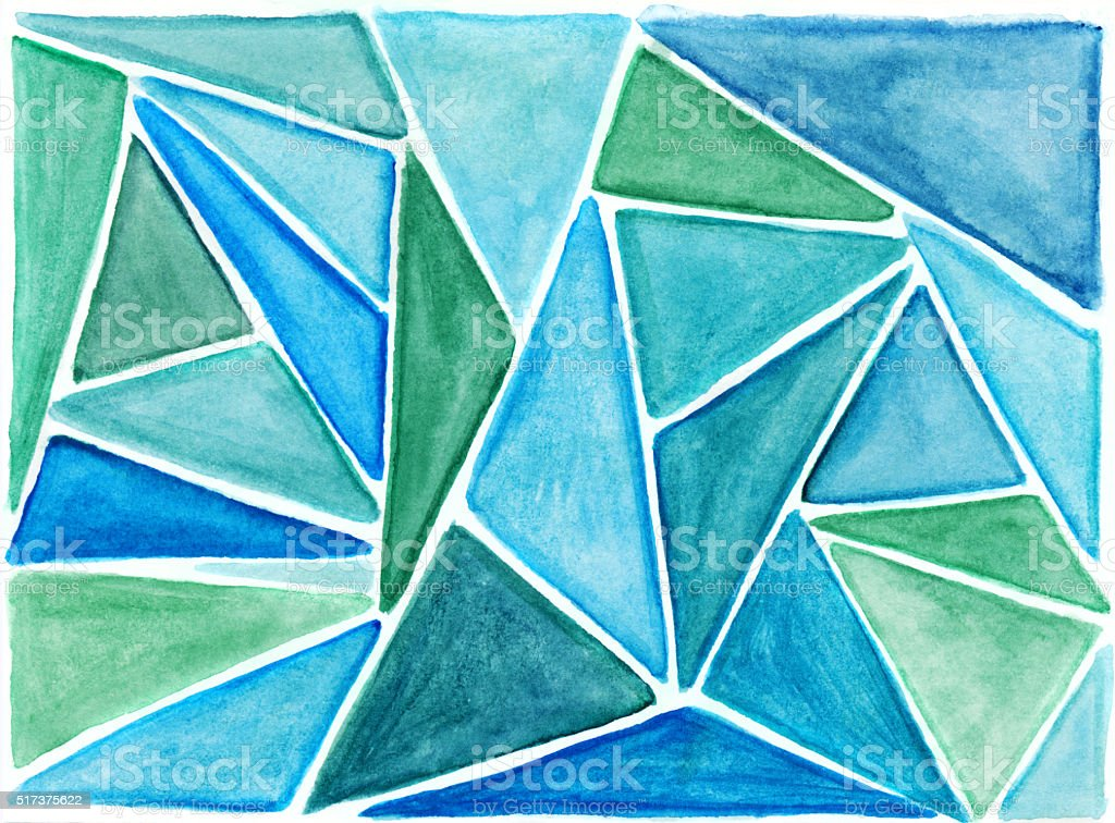 Colorful green and blue triangular shapes hand painted on paper stock photo