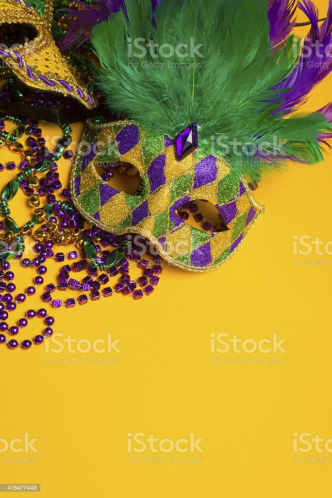 Colorful group of Mardi Gras or venetian masks on yellow stock photo