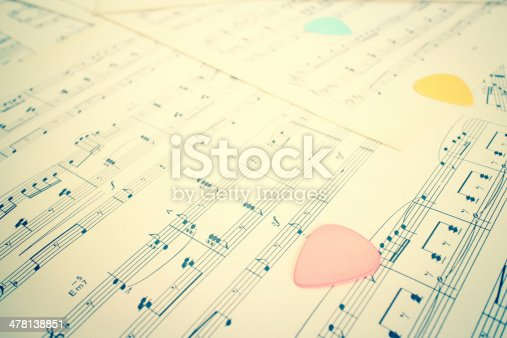 478117515 istock photo colorful guitar picks on music sheet 478138851