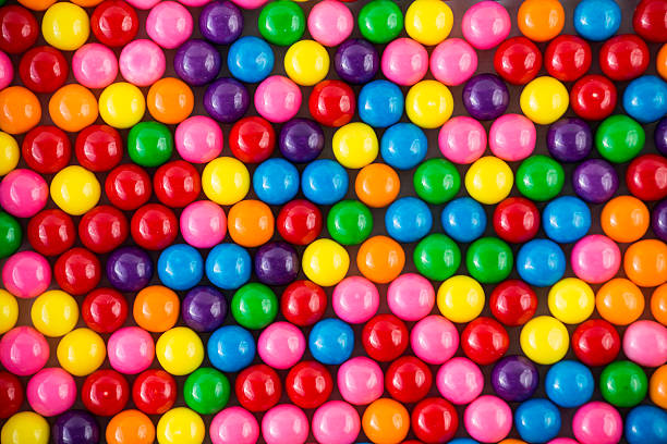 colorful gumballs background image - sakız şekerleme stok fotoğraflar ve resimler