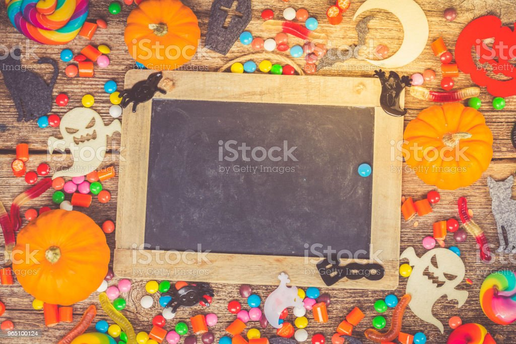 Colorful halloween candies on wood royalty-free stock photo