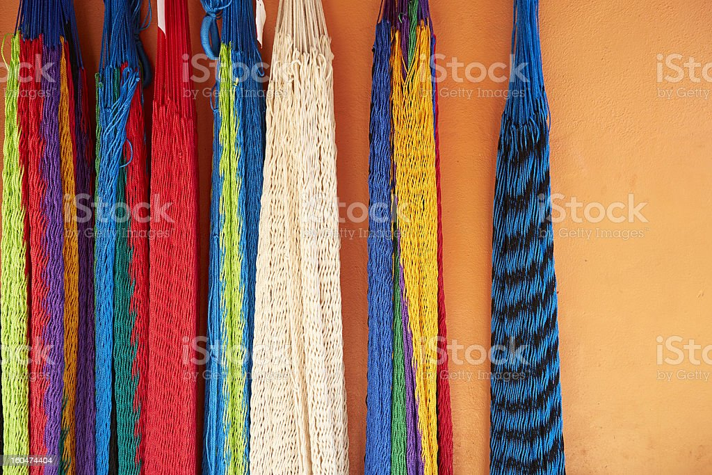 Colorful Hammocks Hang on Orange Stucco Wall, Mexico royalty-free stock photo
