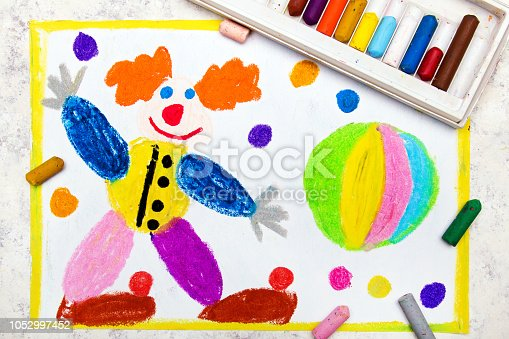 istock Colorful hand drawing: Friendly smiling clown and rainbow ball 1052997452