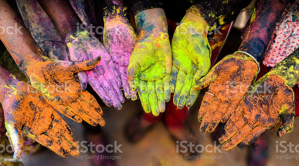Colorful hand in Holi Festival stock photo