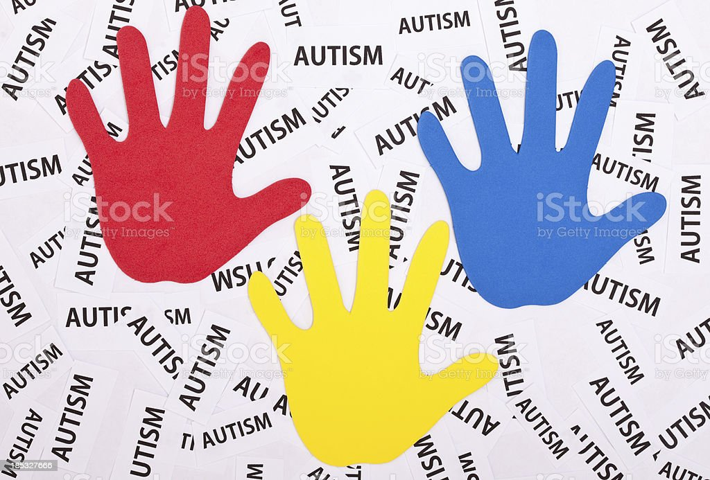 Colorful Hand Prints With the Word Autism stock photo