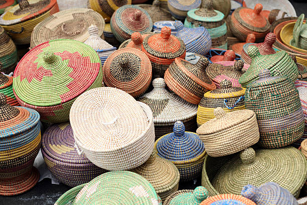 colorful handmade african sea grass baskets - angola stock photos and pictures