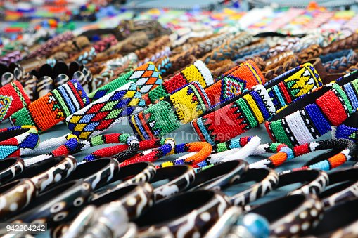 istock Colorful handmade bracelets, bangles at local craft market in South Africa 942204242