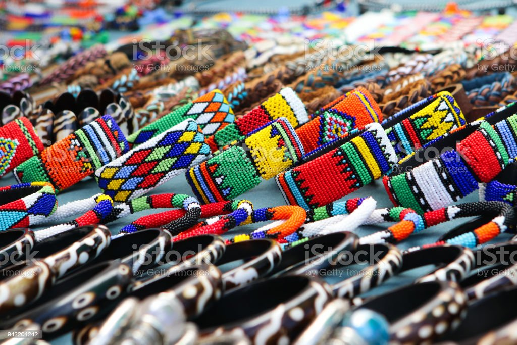 Colorful handmade bracelets, bangles at local craft market in South Africa stock photo
