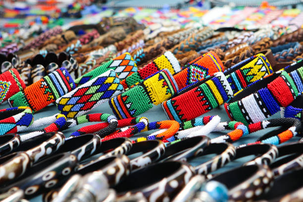 colorful handmade bracelets, bangles at local craft market in south africa - koralik zdjęcia i obrazy z banku zdjęć