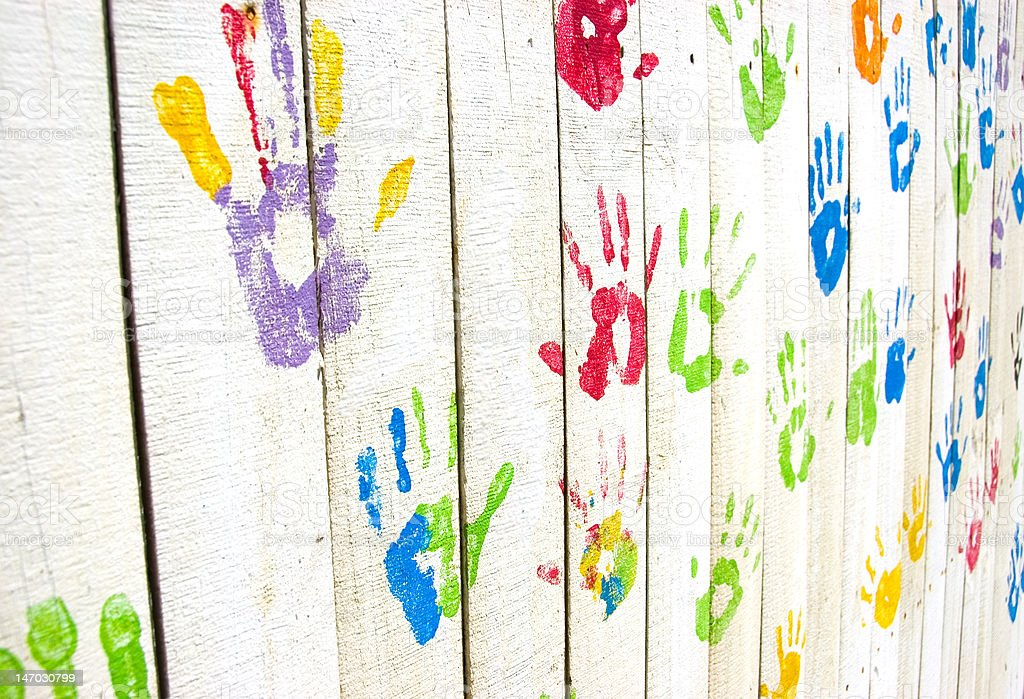 Colorful handprints on wall from an angle royalty-free stock photo