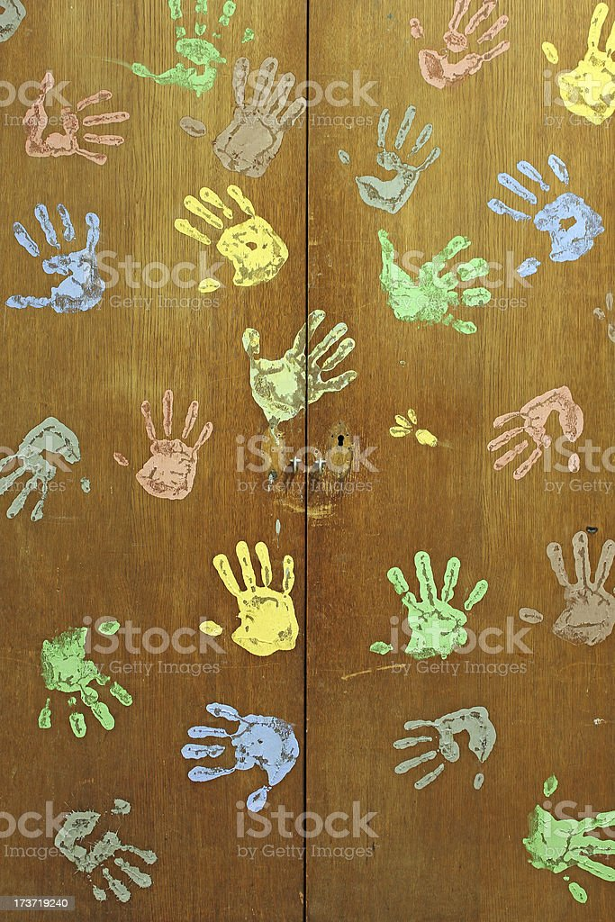 Colorful hands painting from kids on wardrobe - school concept royalty-free stock photo