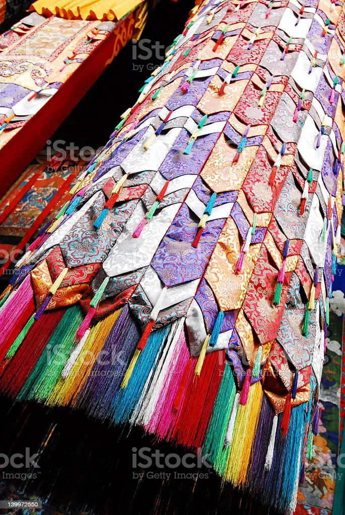 Colorful hanging embroidery inside temple stock photo