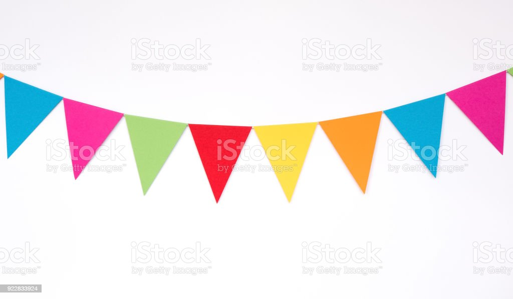 Colorful hanging paper flags on white wall background, decor items for party, festival, celebrate event stock photo