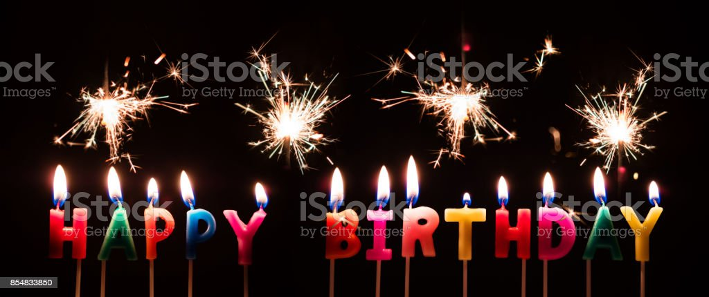 Colorful Happy Birthday Candles With Sparkler Fireworks On Black Background Royalty Free Stock Photo