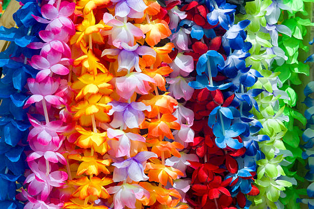 colorful hawaiian lei flowers - hawaiian flowers stock photos and pictures