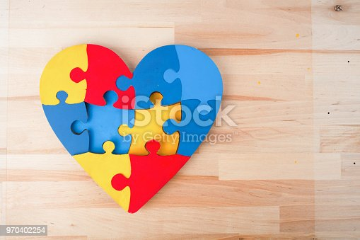 istock A colorful heart made of symbolic autism puzzle pieces. 970402254