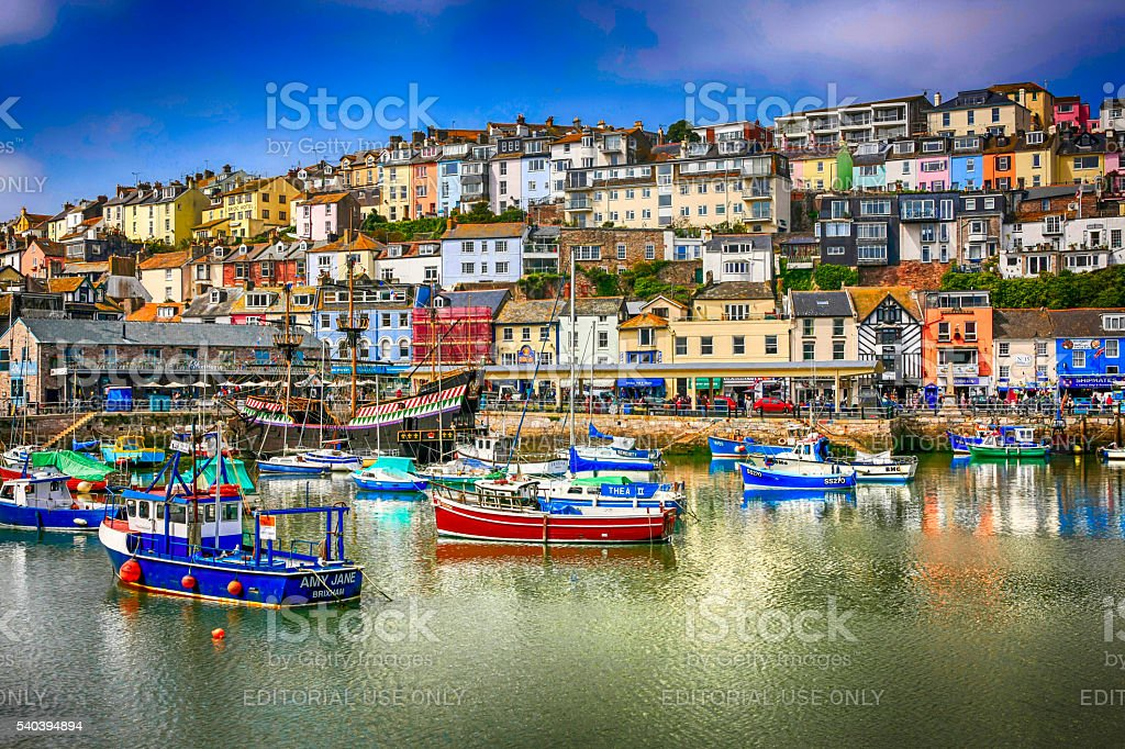 Colorful hillside homes overlooking the harbor at Brixham, UK stock photo