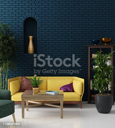 istock Colorful hipster living room with blue brick wall and yellow sofa, bohemian style 1138031802
