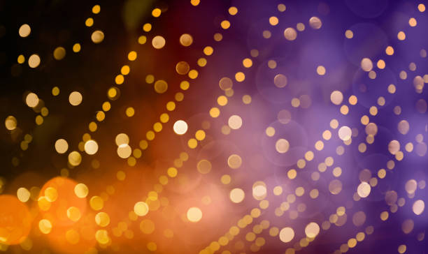 Colorful Holiday Background Bright colorful Holiday background with decorative pattern of Gold spots. Texture of scattering of sparkling bokeh light. Festive Red Yellow Purple Wallpaper carnival celebration event stock pictures, royalty-free photos & images