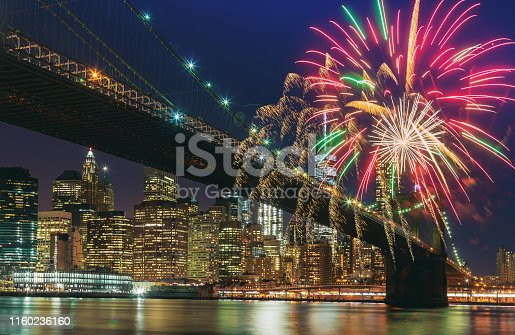 istock Colorful holiday fireworks panoramic view New York city Manhattan downtown skyline at night 1160236160