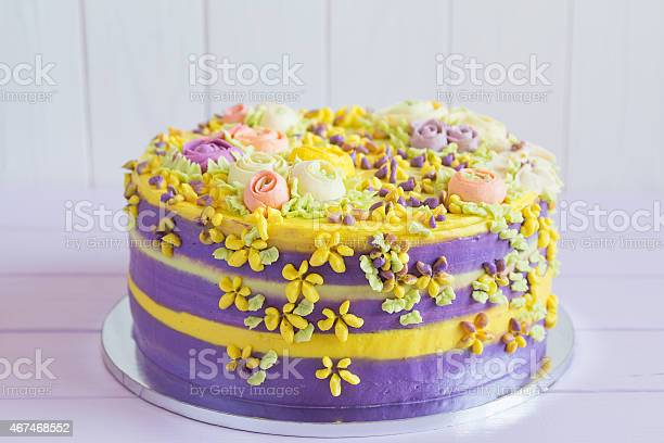 Colorful homemade cake with flowers picture id467468552?b=1&k=6&m=467468552&s=612x612&h=p9rxftsnyacd1ftfpn8ylzp974lpuzytr pqhm9lcwg=