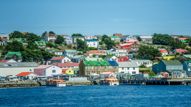 Colorful homes dominate the barren landscape of the Falkland Islands stock photo