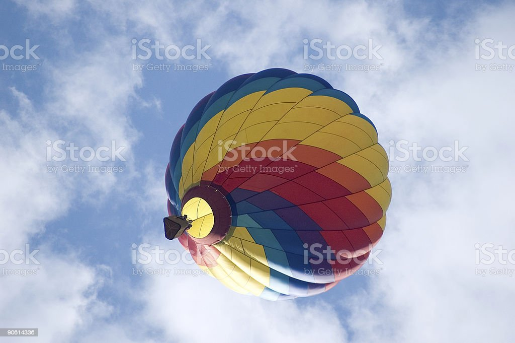 Colorful Hot Air Balloon Amidst clouds royalty-free stock photo