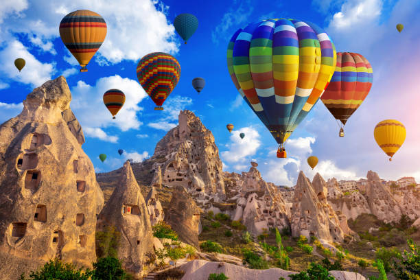 Colorful hot air balloon flying over Cappadocia, Turkey. stock photo