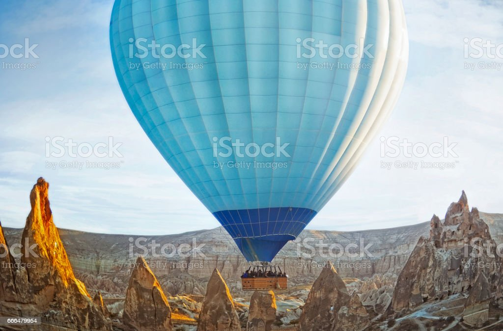 Colorful hot air balloon flying over the valley at Cappadocia stock photo