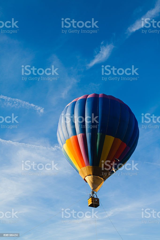 Colorful hot air balloon in blue sky stock photo