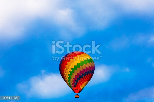 Colorful hot air balloon is flying of nature and blue sky background