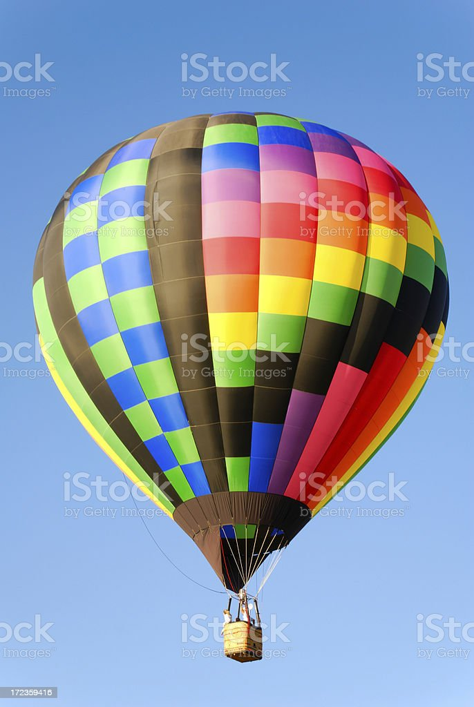 Colorful Hot Air Balloon Isolated on a Blue Sky royalty-free stock photo