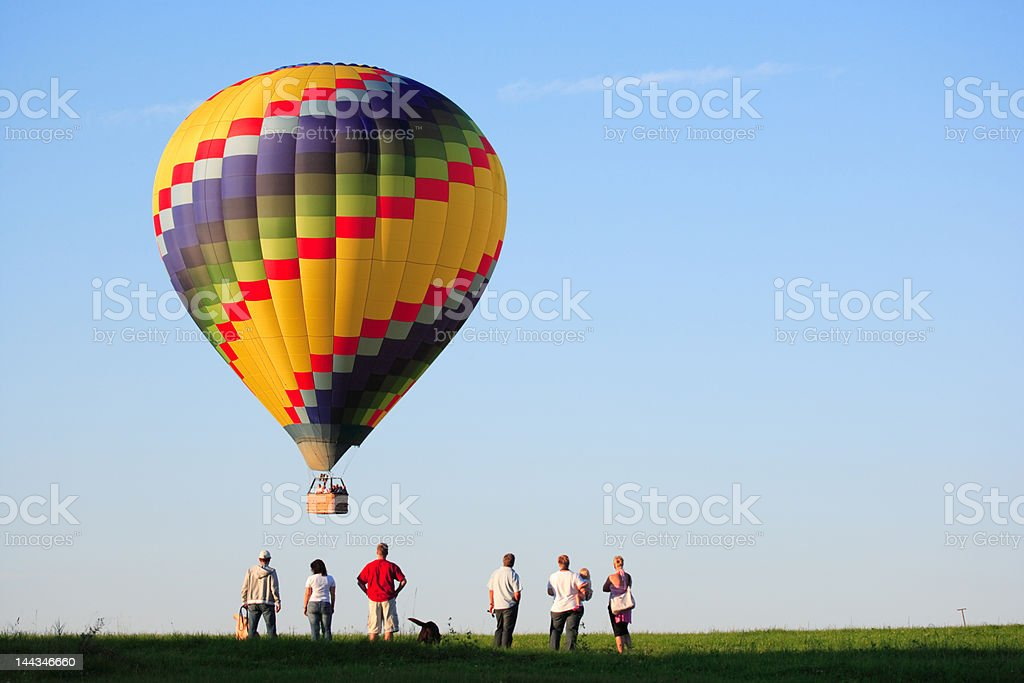 colorful hot air balloon landing stock photo