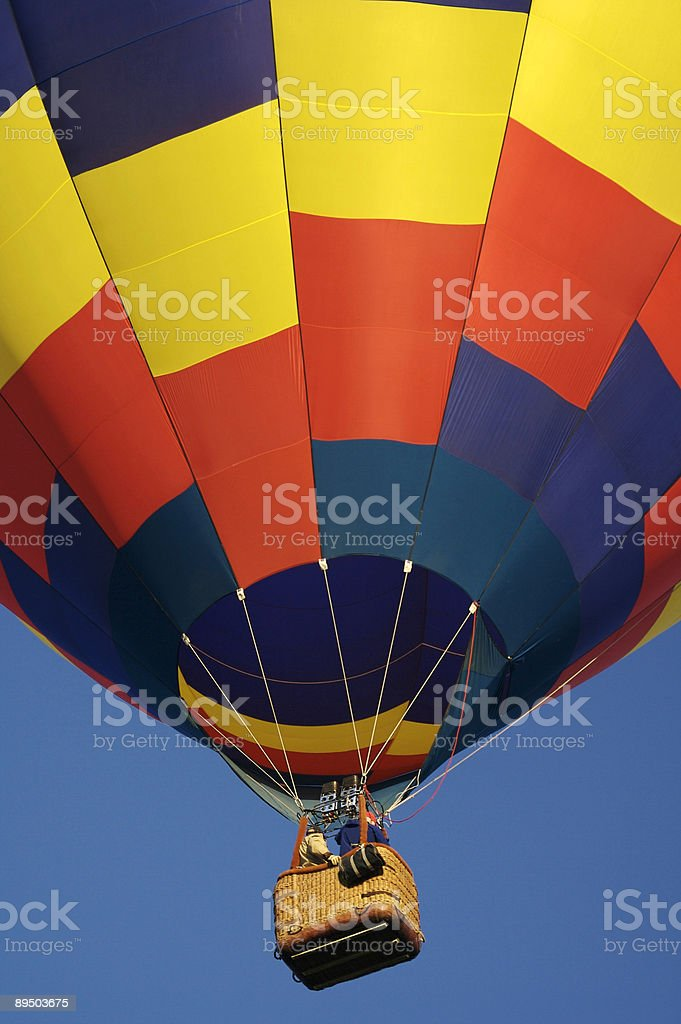 Colorful Hot Air Balloon Lifting Off into the Sky royalty-free stock photo