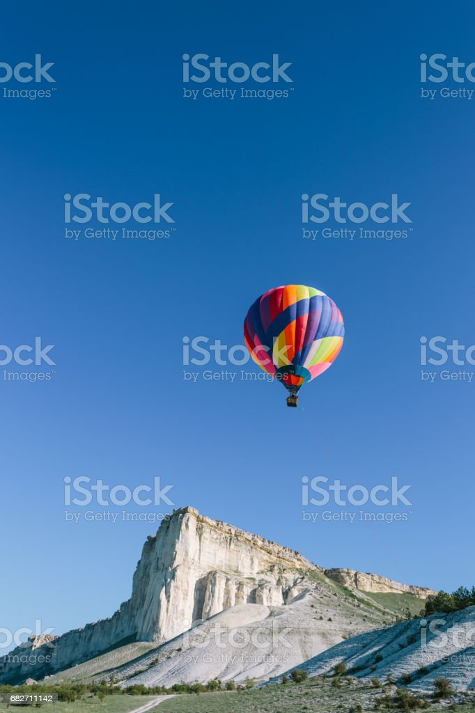 Colorful Hot Air Balloon over Mountains stock photo