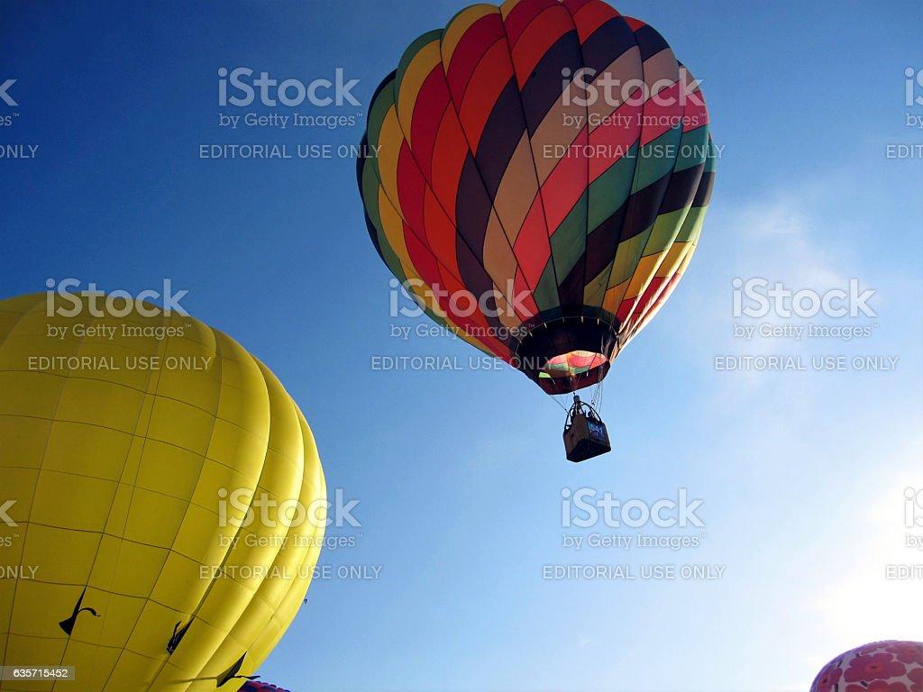Colorful hot air balloon rising royalty-free stock photo