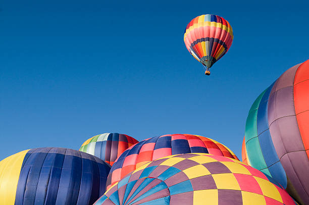 Colorful Hot Air Balloon Rising With Copy Space stock photo