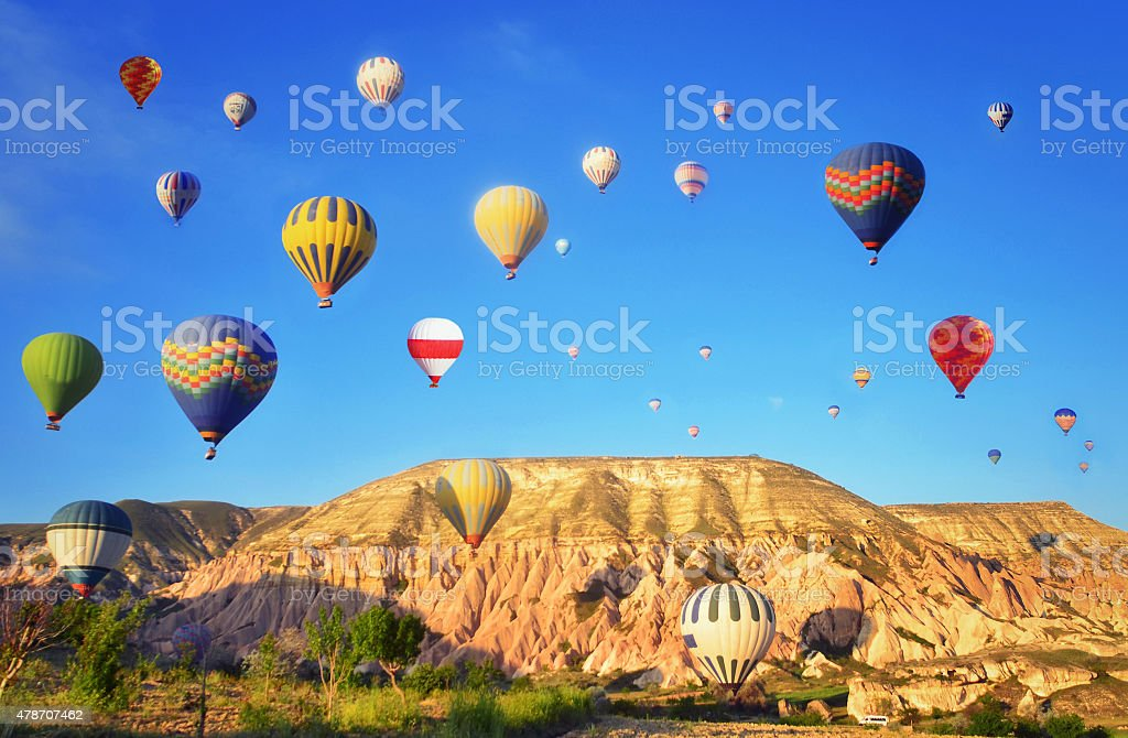Colorful hot air balloons against blue sky stock photo
