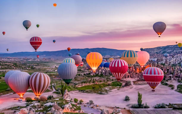 Colorful hot air balloons before launch in Goreme national park, Cappadocia, Turkey Colorful hot air balloons before launch in Goreme national park, Cappadocia, Turkey turkish stock pictures, royalty-free photos & images