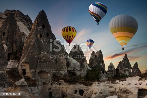 istock Colorful hot air balloons flying over Cappadocia in the morning 1282160731