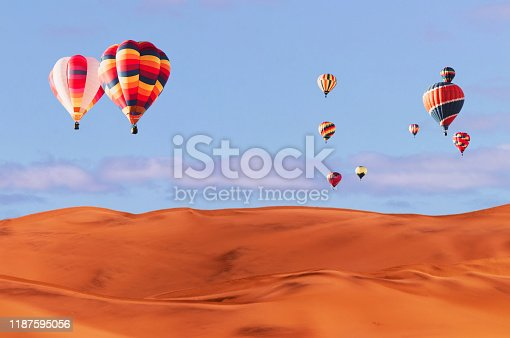530709531 istock photo Colorful hot air balloons flying over sand dune seven, Walvis Bay, Namibia. 1187595056