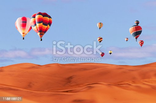 844061492 istock photo Colorful hot air balloons flying over sand dune seven, Walvis Bay, Namibia. 1188188121