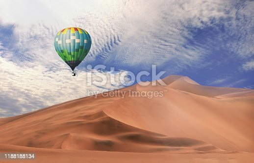844061492 istock photo Colorful hot air balloons flying over sand dune seven, Walvis Bay, Namibia. 1188188134