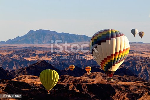 530709531 istock photo Colorful hot air  balloons flying over the moon valley mountain. Africa. Namibia. 1220772962